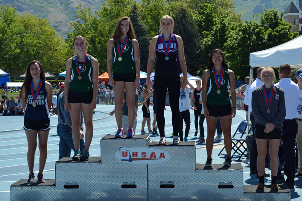 Gracie Otto stands atop the podium at the 4A track and field state championships. Fellow Huskies Tara Sharp (left) and Olivia Finlayson (right) took third and fourth respectively. (Marie Otto)
