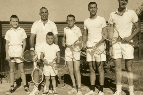 John, his father and his older brothers gather in their tennis gear for a photo. (Ruth Bennett/ John's mother)