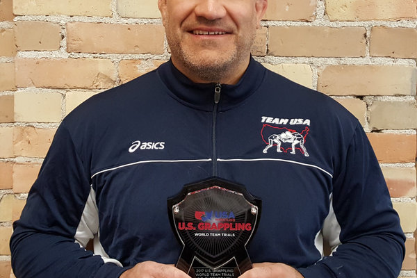 Brandon Ruiz holds his trophy from the national grappling finals in May. He won his division and will represent the United States at the world championships. (Brandon Ruiz/USA grappling)