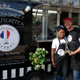 Maxime Ambreza and his wife Raysha pose with their food trailer advertising authentic French crepes. (Keyra Kristoffersen/City Journals)
