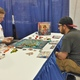 James Truitt and Jeremy Hardman play the tabletop game Yamatai. (Keyra Kristoffersen/City Journals)