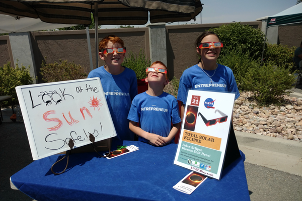 The Picketts sold solar glasses for viewing the upcoming total solar eclipse. They hoped to earn enough money for a trip to see the eclipse later this month. (Jet Burnham/City Journals)