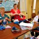 Members of the Sagewood at Daybreak Quilting Club make hooked hats to donate to the homeless shelters. (Keyra Kristoffersen/City Journals)