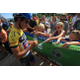 A rider interacts with spectators during a past tour (Jonathan Devich/Epic Images)