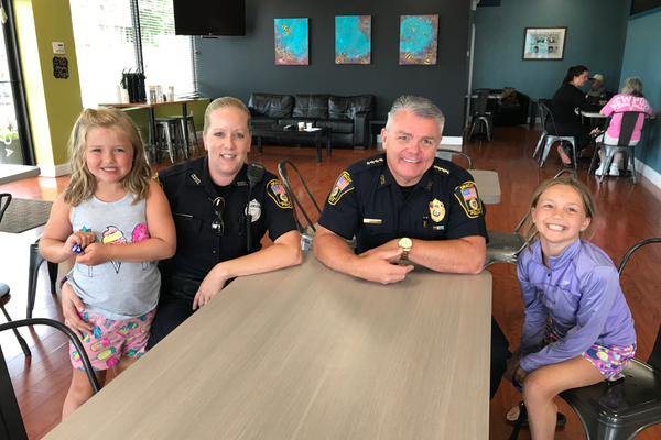 Chloe, 8, and Meredith, 6, Germain had a chance to meet Dracut Police Chief Peter Bartlett and membrs of his department at the Recent Coffee With a Cop event at Frobie's Cafe.