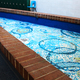 """The """"pond"""" ceramic/glass art piece that replaced a display of plants in a part of the building that belongs to Granite School District. (Jessica Parcell/City Journals)"""