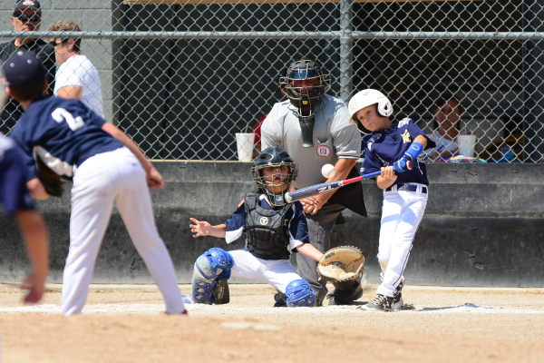 Teams comprised of eight- and nine-year-old kids converged on Hunter Cyprus Babe Ruth League this summer. Their determination to succeed is written in their faces. (Shayne Morrow/Hunter Cyprus)