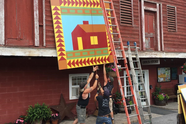 Gill's Construction mounts a quilt on a barn in Juniata county