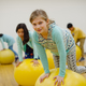 A Lower School student participating in a PE class in the core training room.