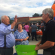 Larry Thomas, a former Ridgecrest Elementary School teacher, talks to Canyons School District Superintendent Jim Briscoe at the 50th birthday party for the school. (Julie Slama/City Journals)
