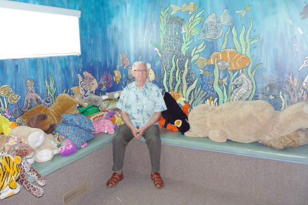 Clinical Director Paul Ricks (pictured) painted this aquatic mural at the Family Support Center. (Carl Fauver)