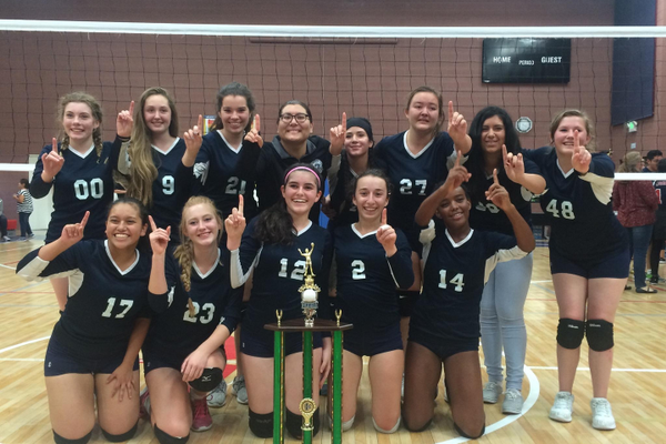 Half the girls from this 2016 AISU championship volleyball team are back to defend their title. (ussasports.org)