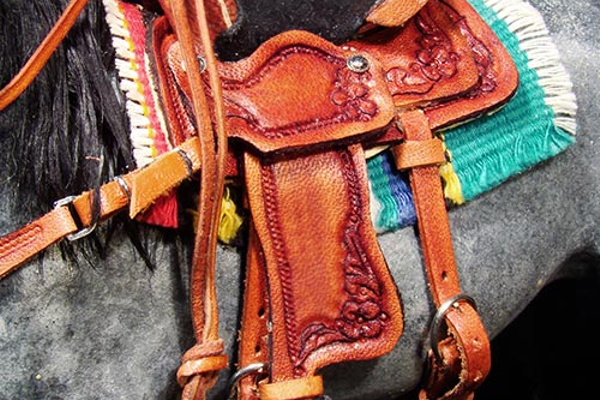 Mackie's miniature saddles have working buckles.