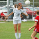 Junior Kyla White heads the ball to a teammate in recent Alta girls soccer action.