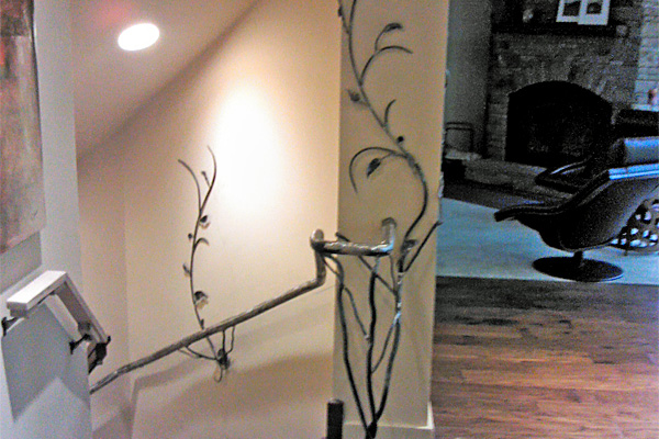 Bell's custom-made railings are both sculptural and functional.