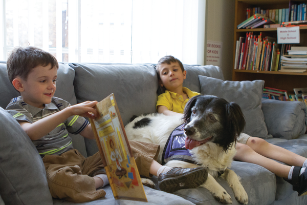 Wyatt Herschell and Sammy Cooper, two of CCN's Canine Kids, spend time reading to Penny. Photo courtesy of Cathy Benscoter, Penn State Beaver