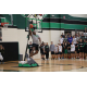 Nov. 27- Dragon Head Basketball Coach Eric McDade completes an impressive reverse dunk during the first ever Celebrity Slam competition at Dragon Madness.