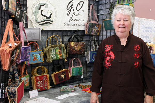Gert Fowler at the Senior Center Craft Fair displays her handmade purses