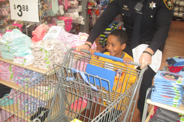 Ezekiel Mayo goes shopping with officer Michael Cabry.