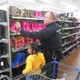Officer Matthew Mendenhall helps Khamille pick out boots for her sister.