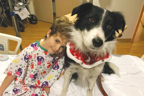 Oakley comforting Case, a patient at Children's Hospital