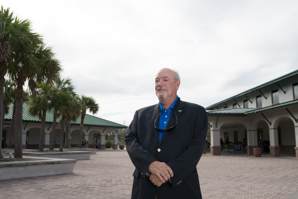 FGCU President Mike Martin in the heart of campus. Photo courtesy of FGCU.