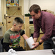 Ryan Scott creates a plaster cast of TJs arm that will help the engineering students accurately size anything they create