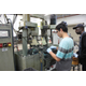A student helps to clean machine parts at Universal Metal Products