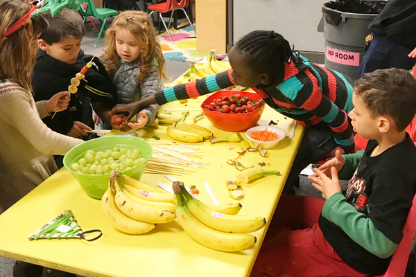 Taylorsville YMCA kids put together their own healthy snacks during their Festival of Kindness. (Joanna Libby)
