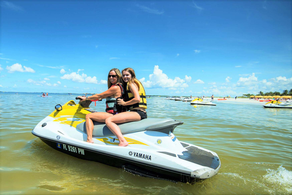 Visitors take out a WaveRunner at Fort Myers Beach. Photo courtesy of Holiday Water Sports.