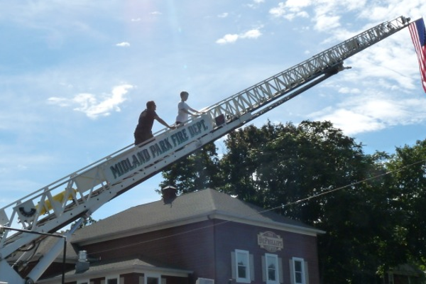 MPFD supervised as kids tested their nerve climbing up the ladder truck on Community Day.