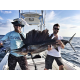 Capt. Ben Chancey (left) and friend with a sailfish they hooked off Florida's east coast. Photo courtesy of Capt. Ben Chancey.
