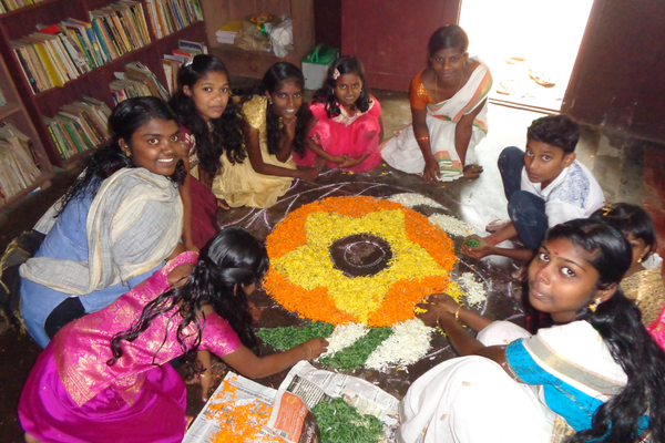 Making the Onam Pookkalam:  Onam is a Kerala harvest festival, celebrated by making a temporary mandala of flowers and rice and by feasting.