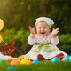 1390448112 230 x 230px toddler girl sitting in the grass with easter eggs