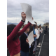 Student organizers lead the Brighton High students in 17 minutes of silence, one minute for each victim in the Florida shootings that took place one month prior. (Julie Slama/City Journals)