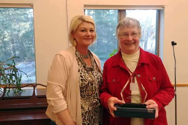 Current Emergency Management Director Valerie Marasco Presents former Emergency Manager Nancy Koss with an Outstanding Career Recognition Award. Photo credit: Rhonda Silence