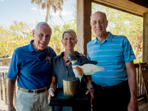 Artist Jim Sprankle Brush of Excellence Chair Sandy Gross and 2018 Winner Phil Weyman Photo courtesy of the Sanibel-Captiva Conservation Foundation