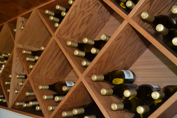 The shelves behind the tasting room bar area are always well stocked. (Photo by Richard Gaw)