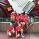 Christy LaPaglia board president of Share A Vision top row second from right stops to take a picture with the siblings of the children with autism on the 2017 SAV trip to Disney  Oftentimes siblings of children with autism are overshadowed because their sibling requires so much attention  Share A Vision makes sure that they feel just as important as their sibling with autism