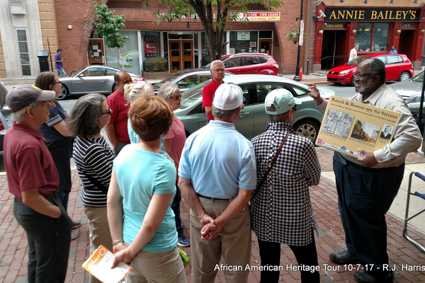 Gerlad Wilson tells a group of tour participants of Thaddeus Stevens' spies.