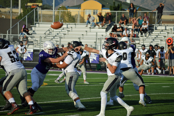 Indy Hanson throws a pass on Alta's first drive of the game.