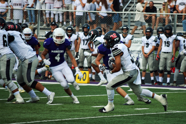 Senior running back Gooch Malietulua takes a hand-off into the teeth of the Lehi defense.