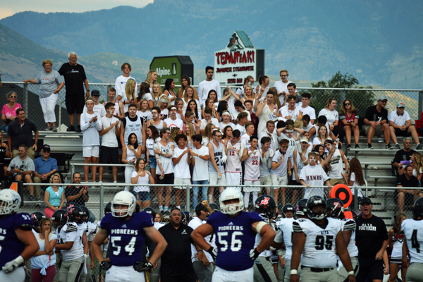 The Alta student section celebrates after the Hawks defense makes a stop.