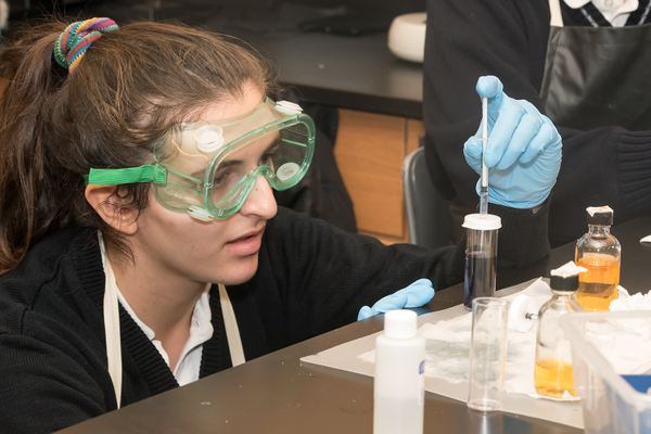 2018 graduate Katarina Mico, working in the science lab.