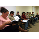 The cast of Mushroom reads a draft of the play on Oct 19 at La Communidad Hispana The author Eisa Davis is at center