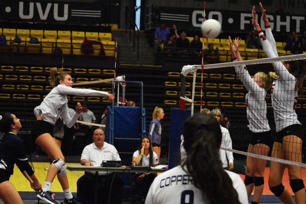 Senior captain Payton Birch unleashes a spike during the state tournament. (Justin Adams/City Journals)