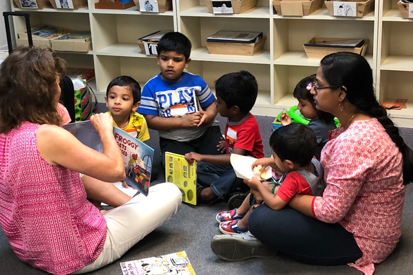 Lora Venturella reads to children in North Hills Cares' summer reading program.