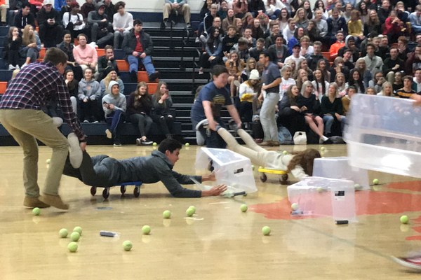 Brighton High students played Hungry Hippos to raise support for the Utah Refugee Center at their final fundraising assembly. (Julie Slama/City Journals)