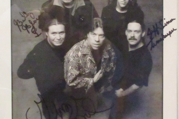 A signed photo by Newark's success story, George Thorogood and the Destroyers.