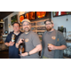 Joe Stickel TJ McGrath and Mike Dunlap of the Midnight Oil Brewing Company